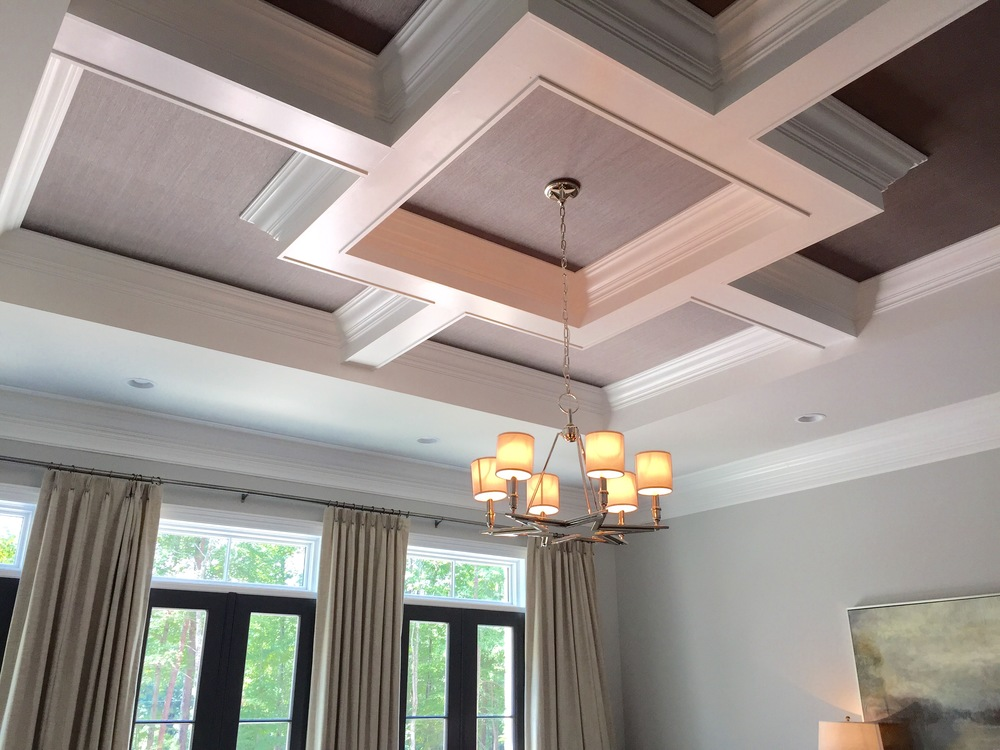 Grasscloth made for an interesting coffered ceiling. In an otherwise neutral rom, this soft purple ceiling stood out.