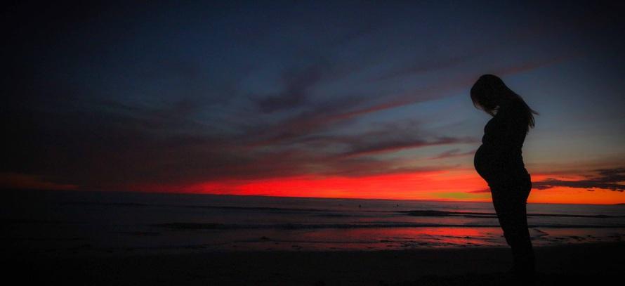 pregnant-beach-sunset-mother-51386-large.jpeg