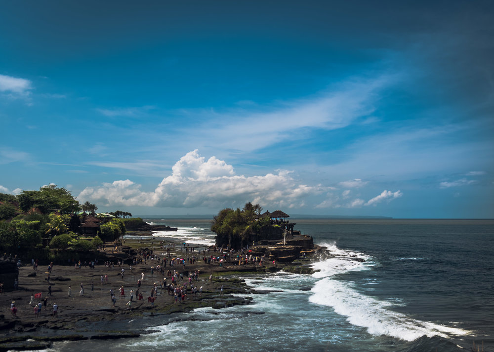 A view of Tanah Lot Temple during its busiest hour. Literally a swarm of tourists.