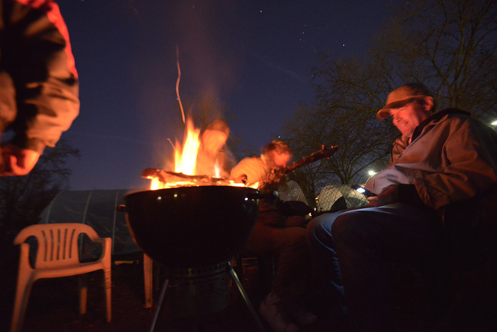 Eugene, Ore. - Nightingale members spend time together during the winter season with a bonfire. The fire is regulated with a barbecue stove to prevent a wildfire. By: Debra Josephson