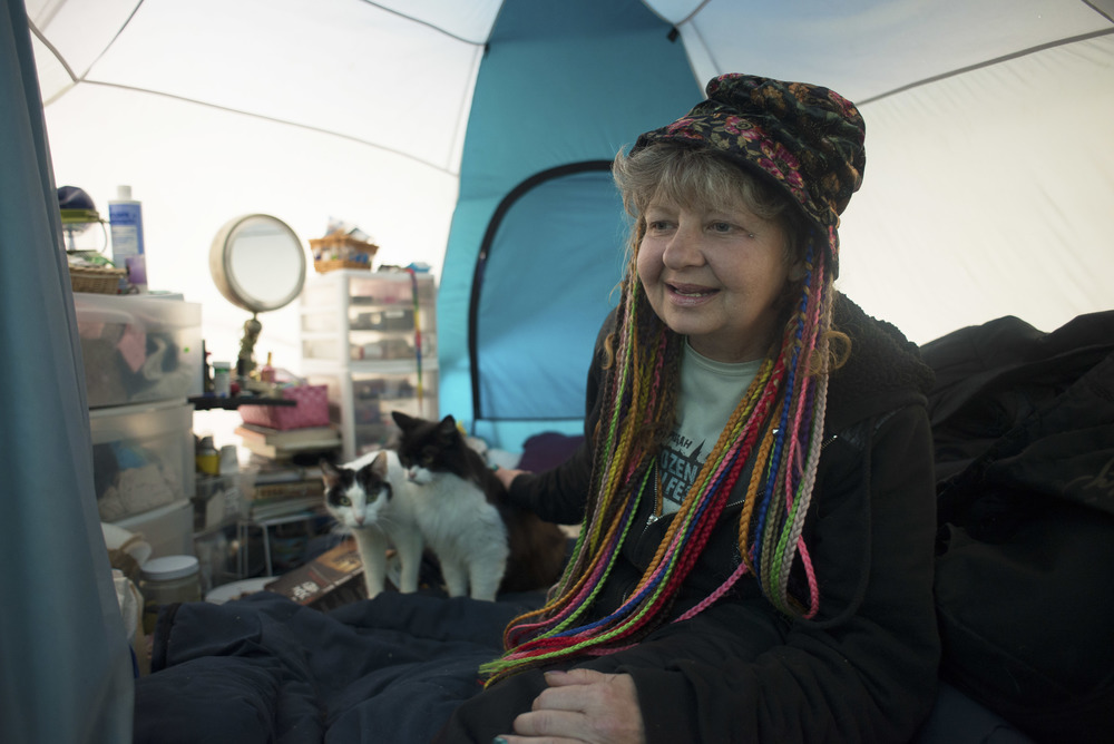 Eugene. ORE. - Julie Lambert keeps her cats safe and well fed within her personalized tent at Nightingale Health Sanctuary. Photo by: Debra Josephson