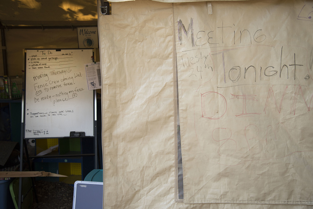 Eugene, ORE - A whiteboard in the office tent is typically used for sharing information about upcoming meeting topics or chores needed done at camp. By: Debra Josephson