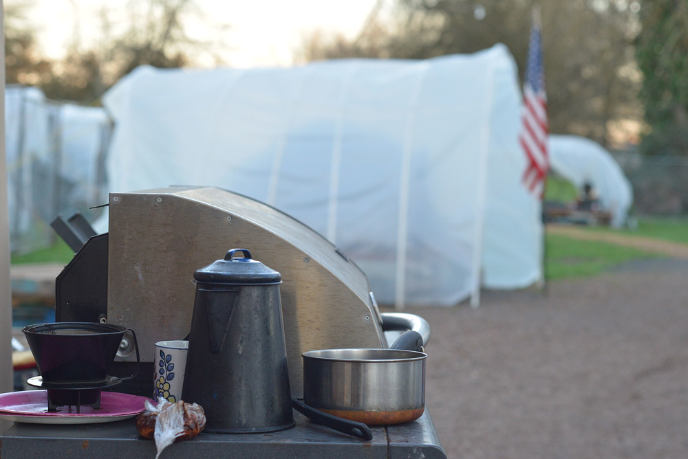 Eugene, ORE - Cast iron Coffee pot and kitchenware compatible to use with the propane grill and heaters. No electricity is available at rest stop. By: Debra Josephson