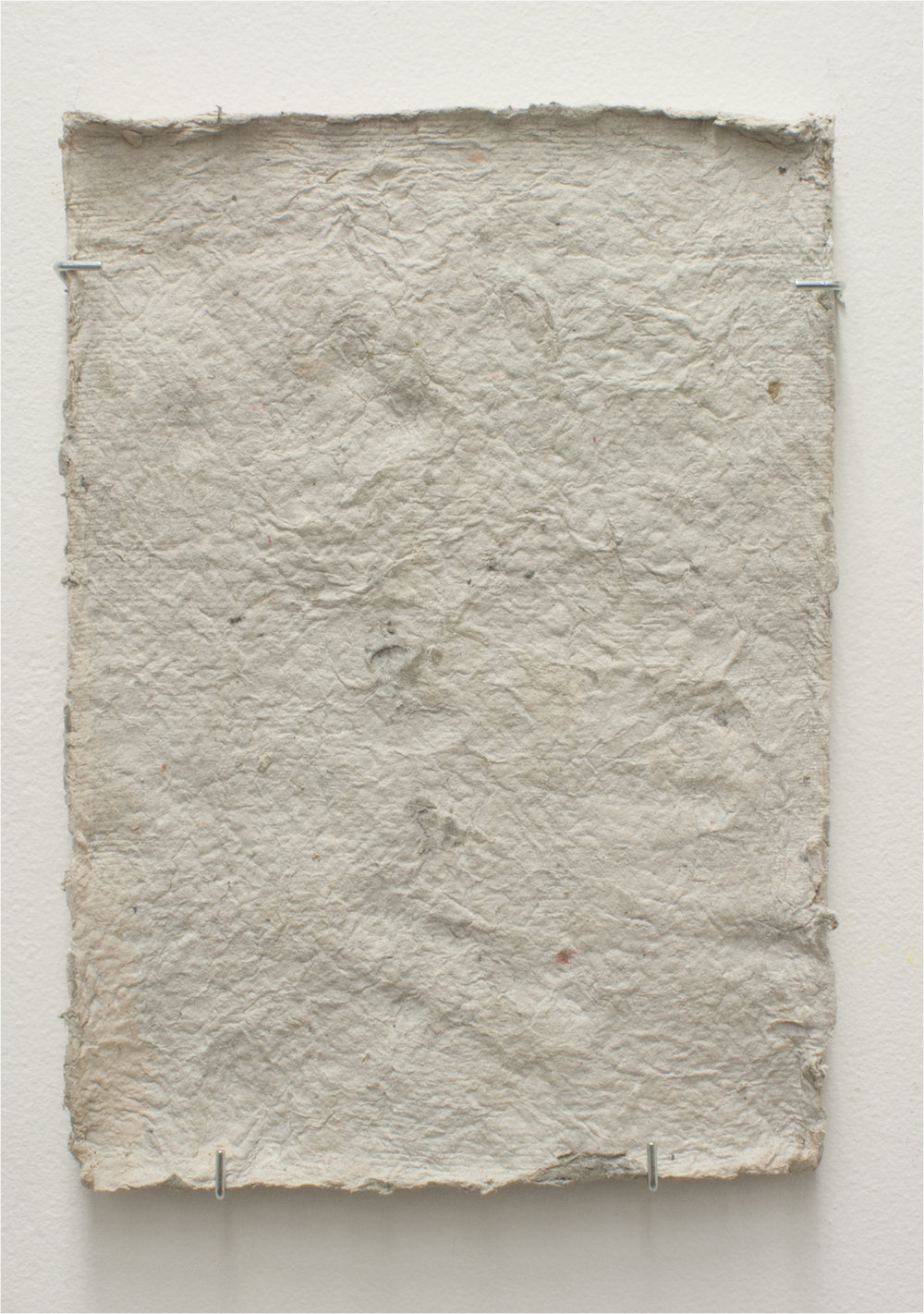"unfurled    Plaster, Detritus Paper, Leaves, and Unfired Clay   48"" x 11"" x 1""  2016"