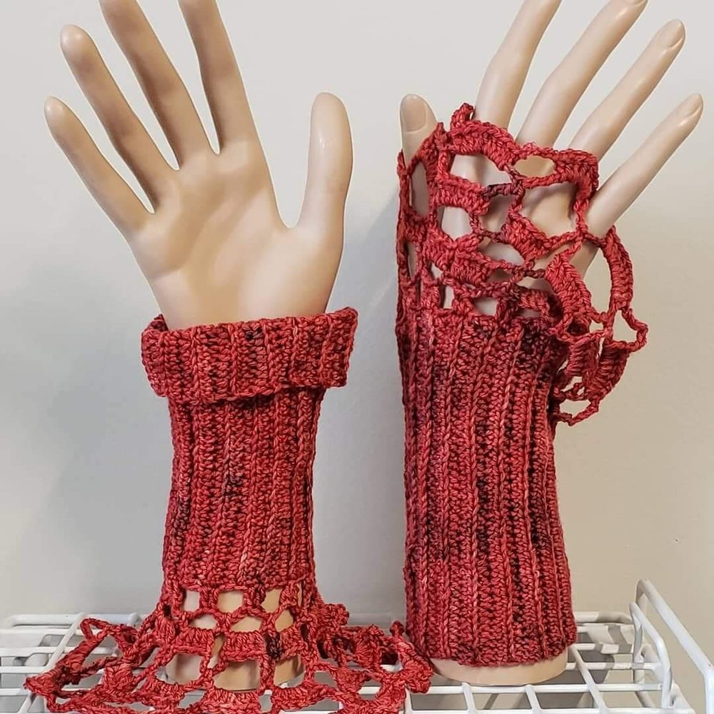 Reversible Gauntlets - These are beautiful gauntlets that can be worn in two different ways. These are fun and beautiful wrist gauntlets.Requirements: 175-220 yds of Fingering/Sock yarnYarn Shown: Claire: Lady in Red in Deluxe Sock**This color way is currently on clearance**