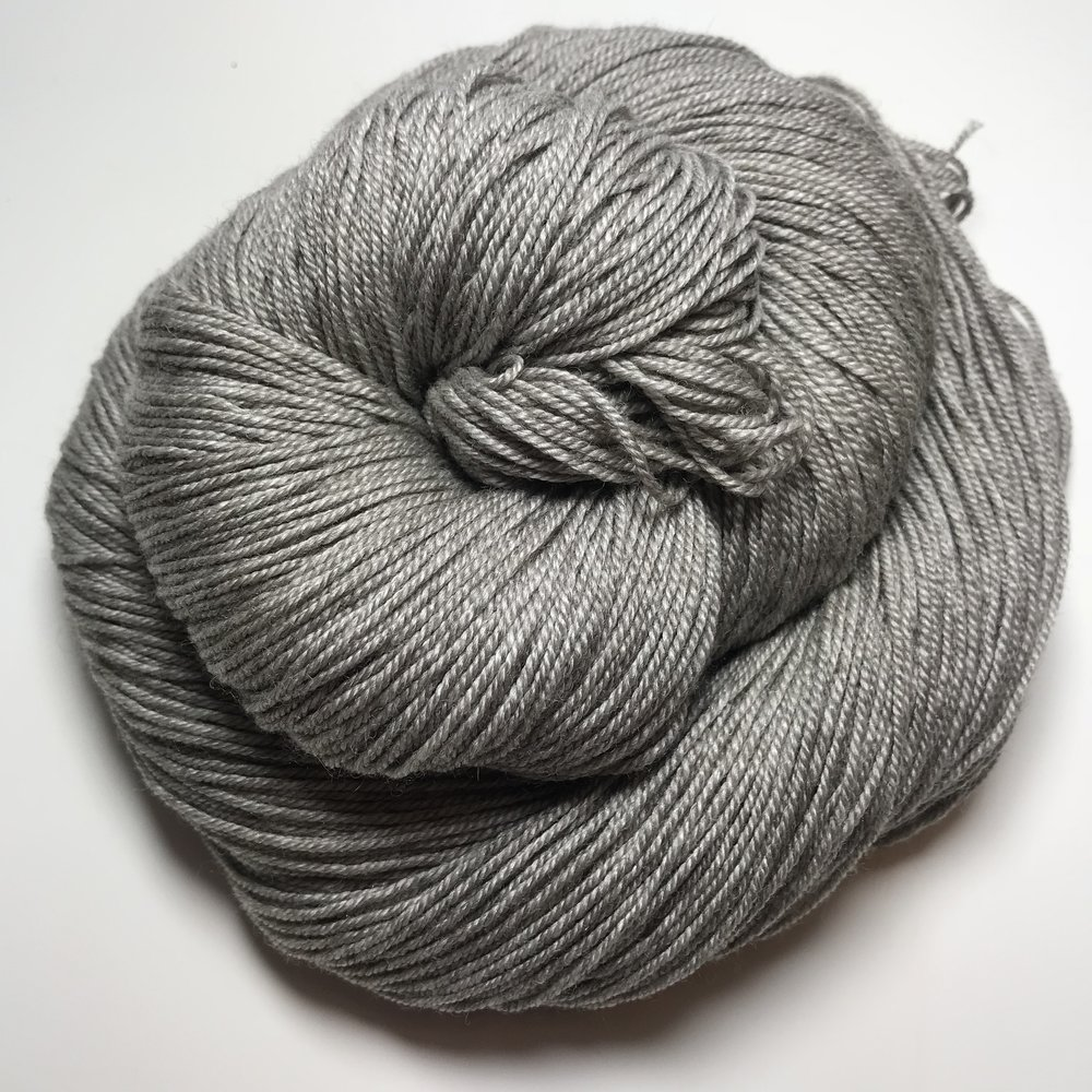 Queen Bee Sock - $40 3-ply 65/20/15 SW Merino/Silk/Yak. This is an absolutely luxurious yarn base. The gray brings a richness to every color that is put on top of it.100g/400m/438yds