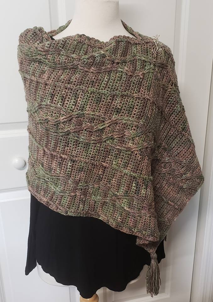 Key to the Kingdom Wrap - This design is by Kim Simpson for the Fall 2018 Outlander KAL/CAL. This pattern will be available October 1, 2018 and a link to the pattern will be added when it becomes available.Requirements5 skeins (1,300 yds) of DK weightAs pictured: Colum Mackenzie on sustainable dkFor custom color/base, please click HERE