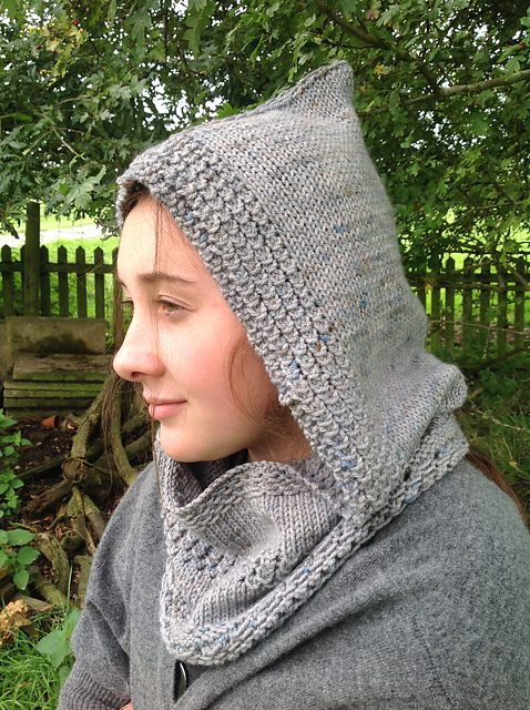 In Hiding Hooded Cowl - This pattern was designed for the Fall 2017 Outlander KAL/CAL.Requirements:246-366 yards of DK**Please pay attention to the length of your selected yarn as different bases vary in length**As shown: Young Fergus on Sustainable DKFor custom colors/bases click HERE