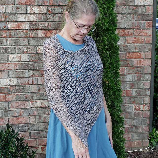 Petals Poncho - This design is by Kim Simpson for the Fall 2018 Outlander KAL/CAL. This pattern is now available.Available in 3 sizes, s/m, l/xl and 2/3x.Requirements:Fingering weight 2 [2, 3] skeins, or approximately 587 [670, 880] yards**Please pay attention to the length of your selected yarn as different bases vary in length**As shown:Burnished Steel on Silky SockFor custom colors/bases click HERE