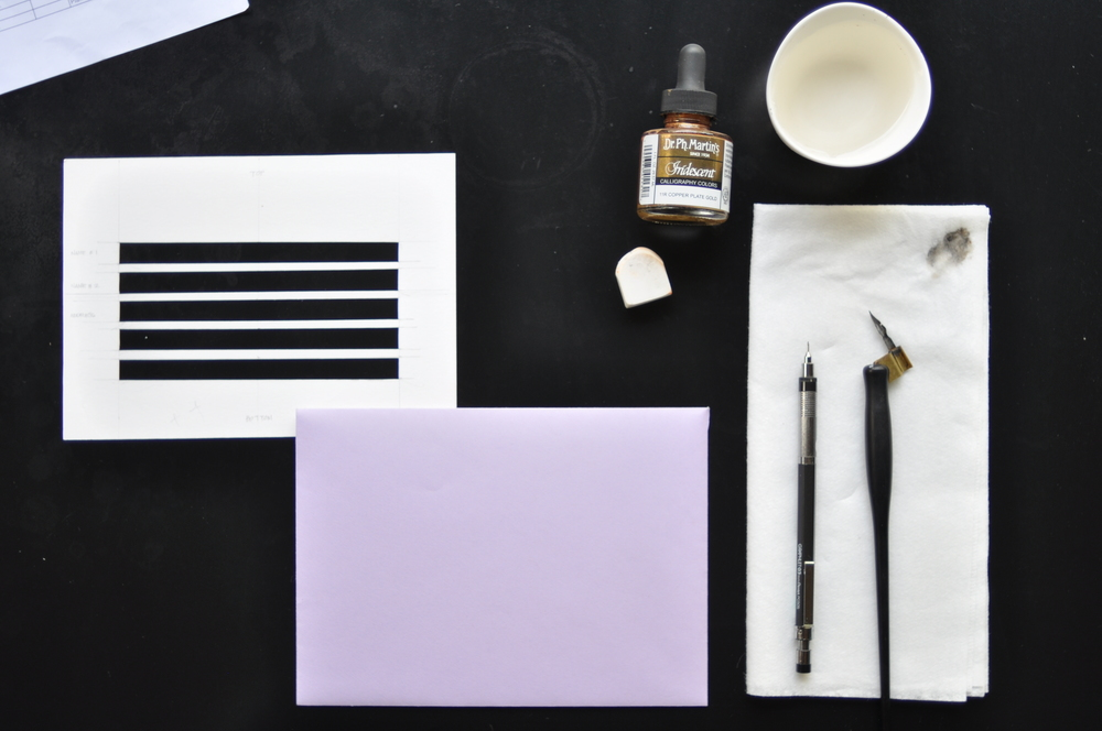 What you need: Cut-out template from heavy cardstock, a lead pencil, all the calligraphy necessities, and eraser to erase your guidelines.