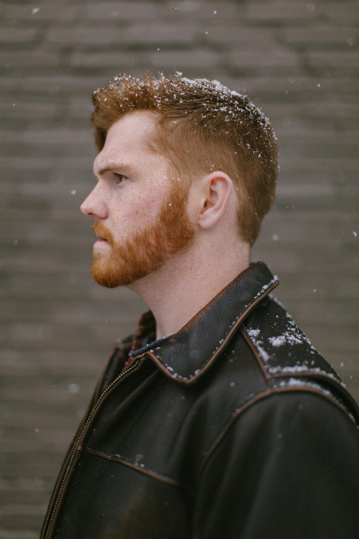 redhead male in snow profile web.jpg