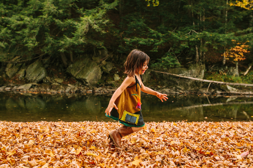 child playing in vermont autumn river web.jpg