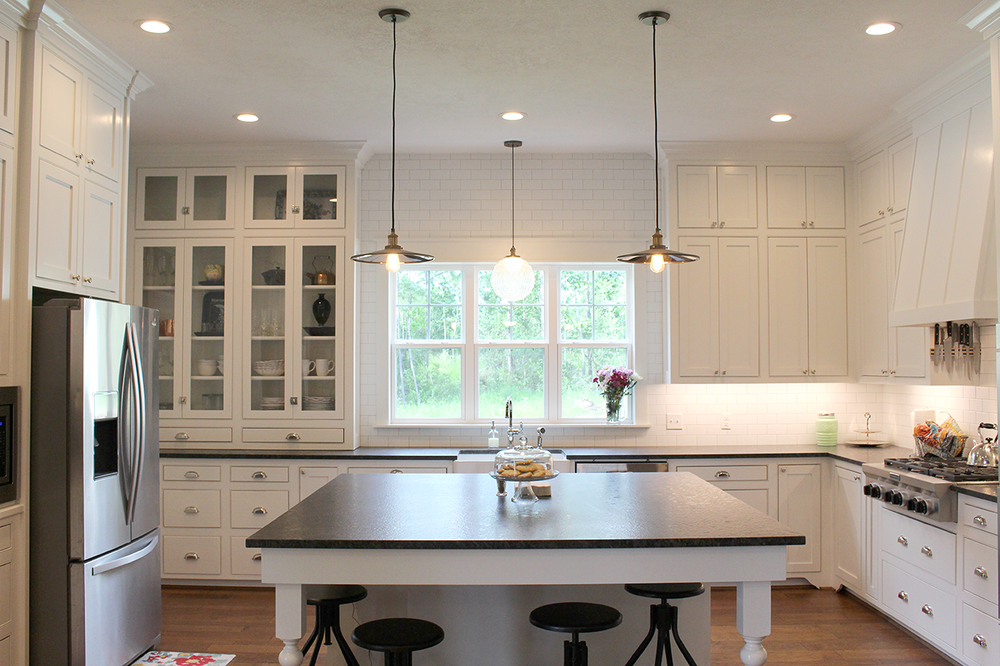 And then the angels starting singing. I. LOVE. MY. KITCHEN. It's an absolute dream to cook in here. From the inset shaker cabinets and stainless appliances, to the perfect shade of creamy white and our beautiful counters...it's perfect. What's on our counters, you ask? It's leathered (or sometimes called antique) black granite. I'll leave the story of how we picked that out for another day.