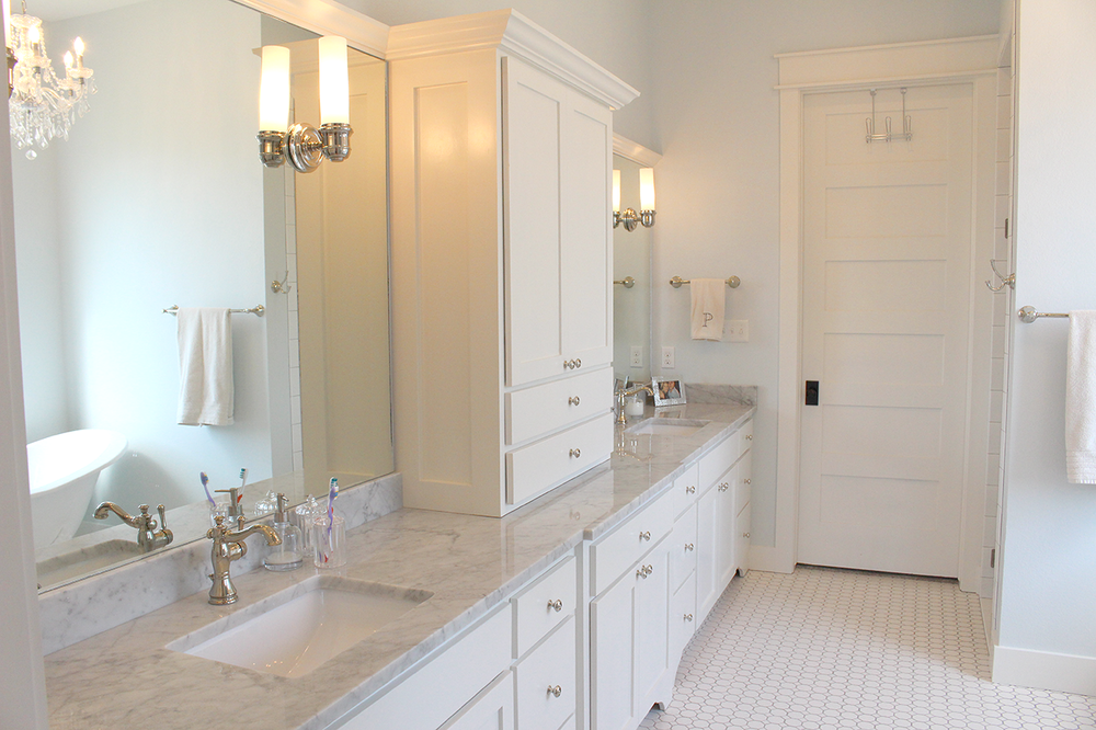 Here's my escape. It's our master bath. We did a matte hexagon-dot tile on the floor with a warm medium gray grout. On the counters, we did carrara marble. In both the master bath and the kitchen, all the hardware is polished nickel.