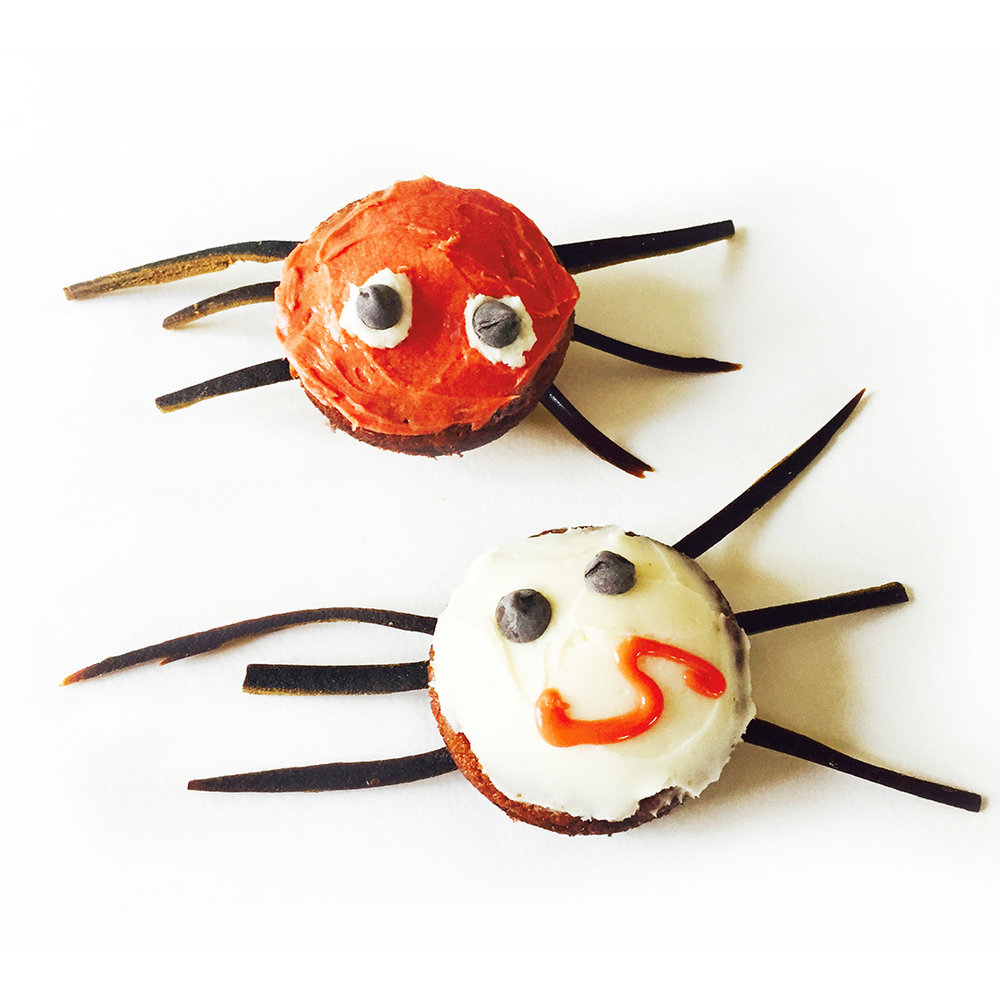 Can spiders be cute? There's nothing to be afraid of with naturally colored orange frosting.