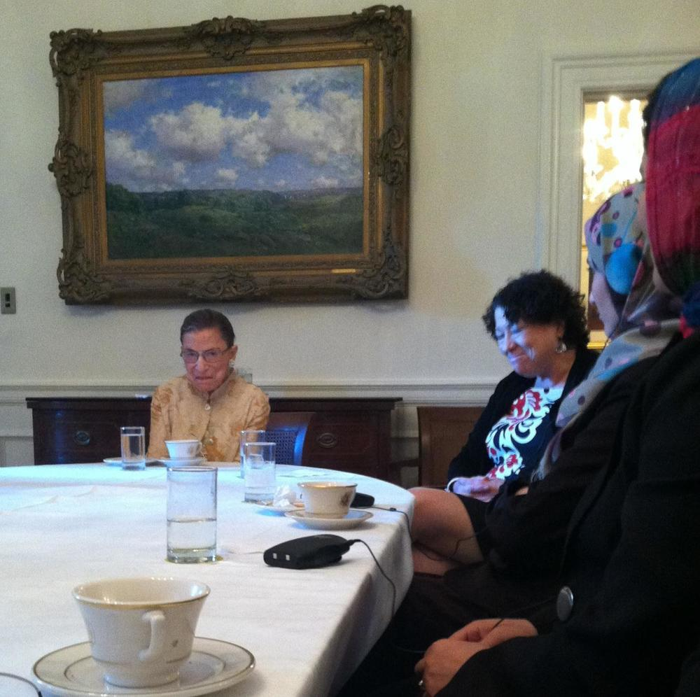 If you look closely, you can see the cookie behind RBG's water glass in this photo.