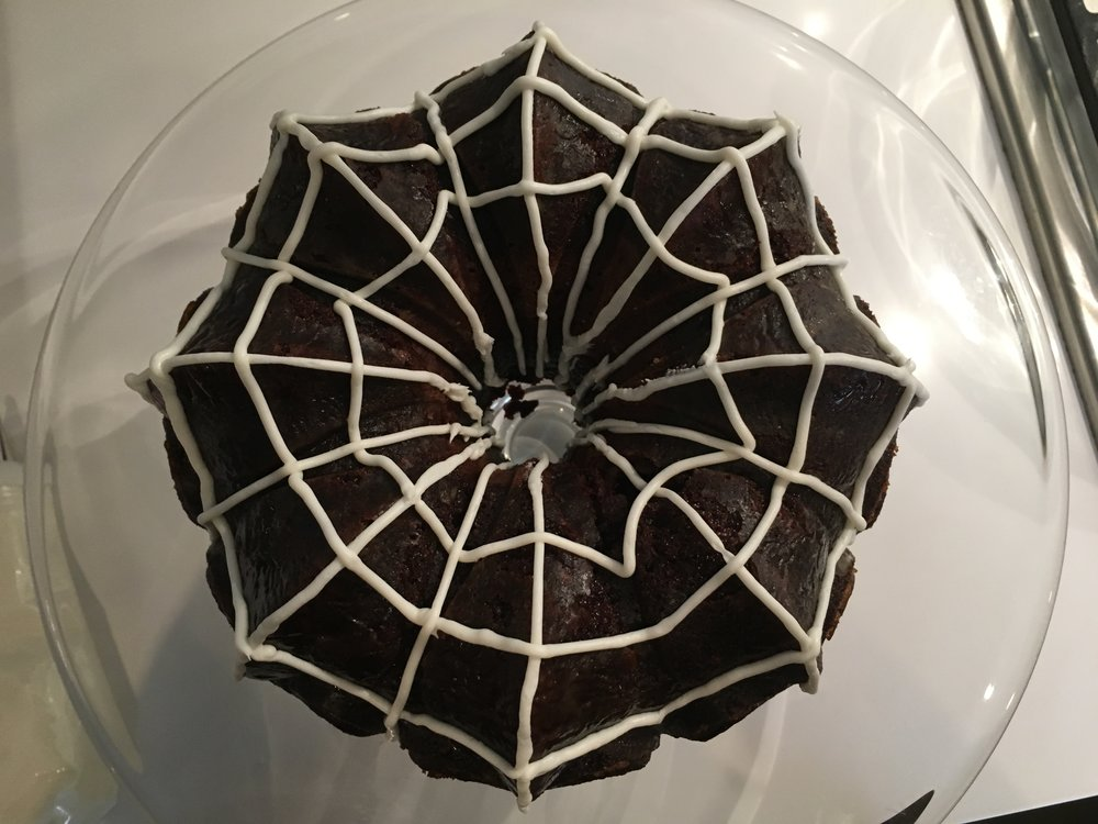 Here's a version I made for a Halloween party! Just skip the powedered sugar and instead pipe on a spider web! The bundt shape really lends itself to the design.