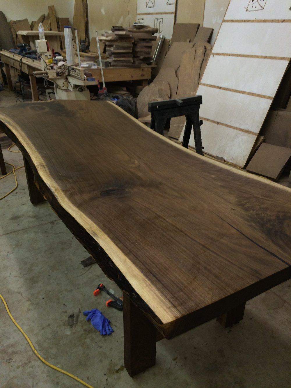 Live edge black walnut dinning room table with black walnut legs