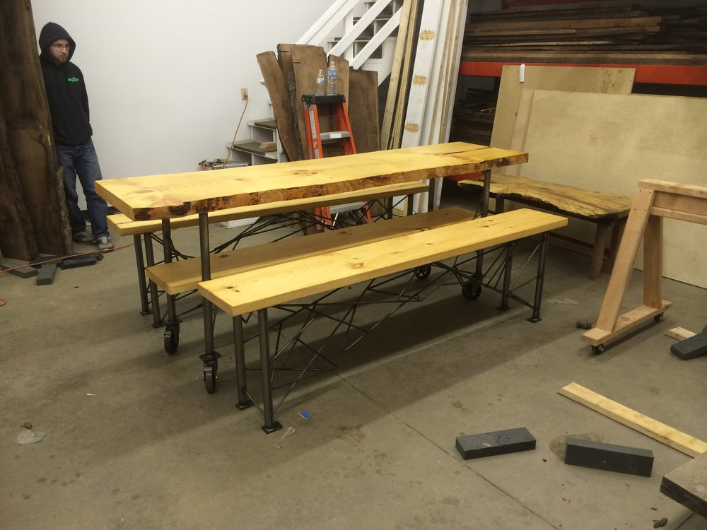 Live edge white pine dinning room table and benches with steel legs on vintage casters