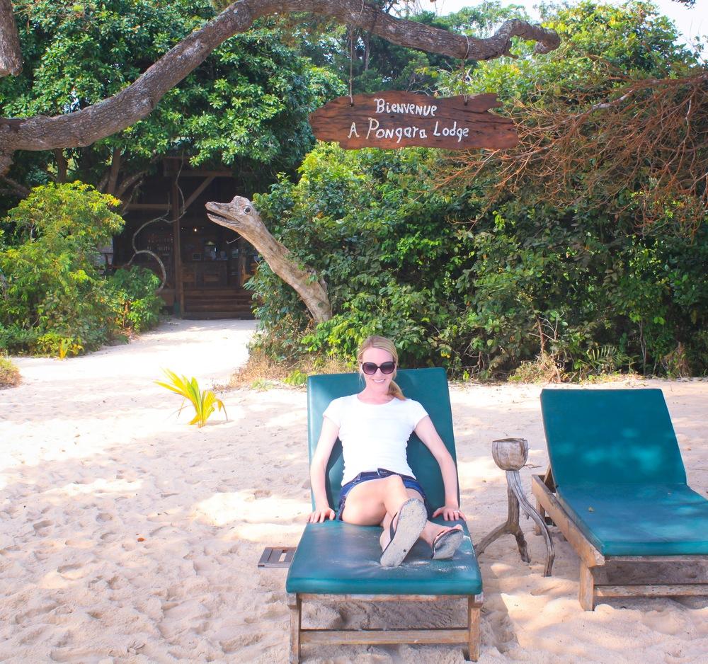 Sitting on the beach at Pongara Lodge.