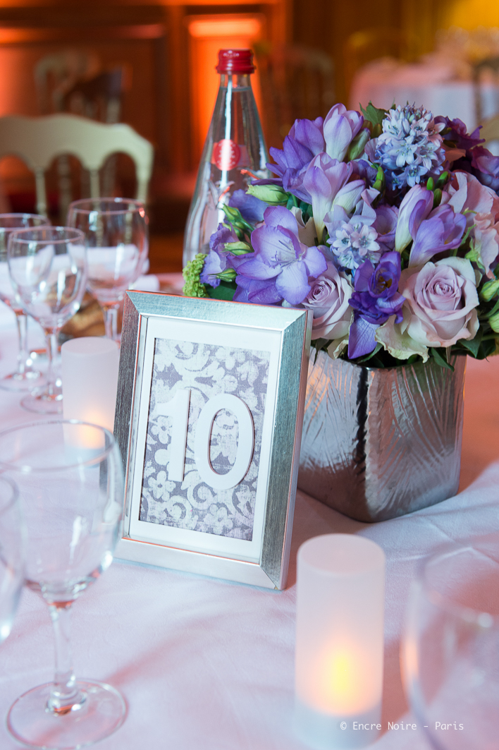 Centerpieces for reception incorporating purple lysianthus, lime green viburnum and Memory Lane vintage lilac roses