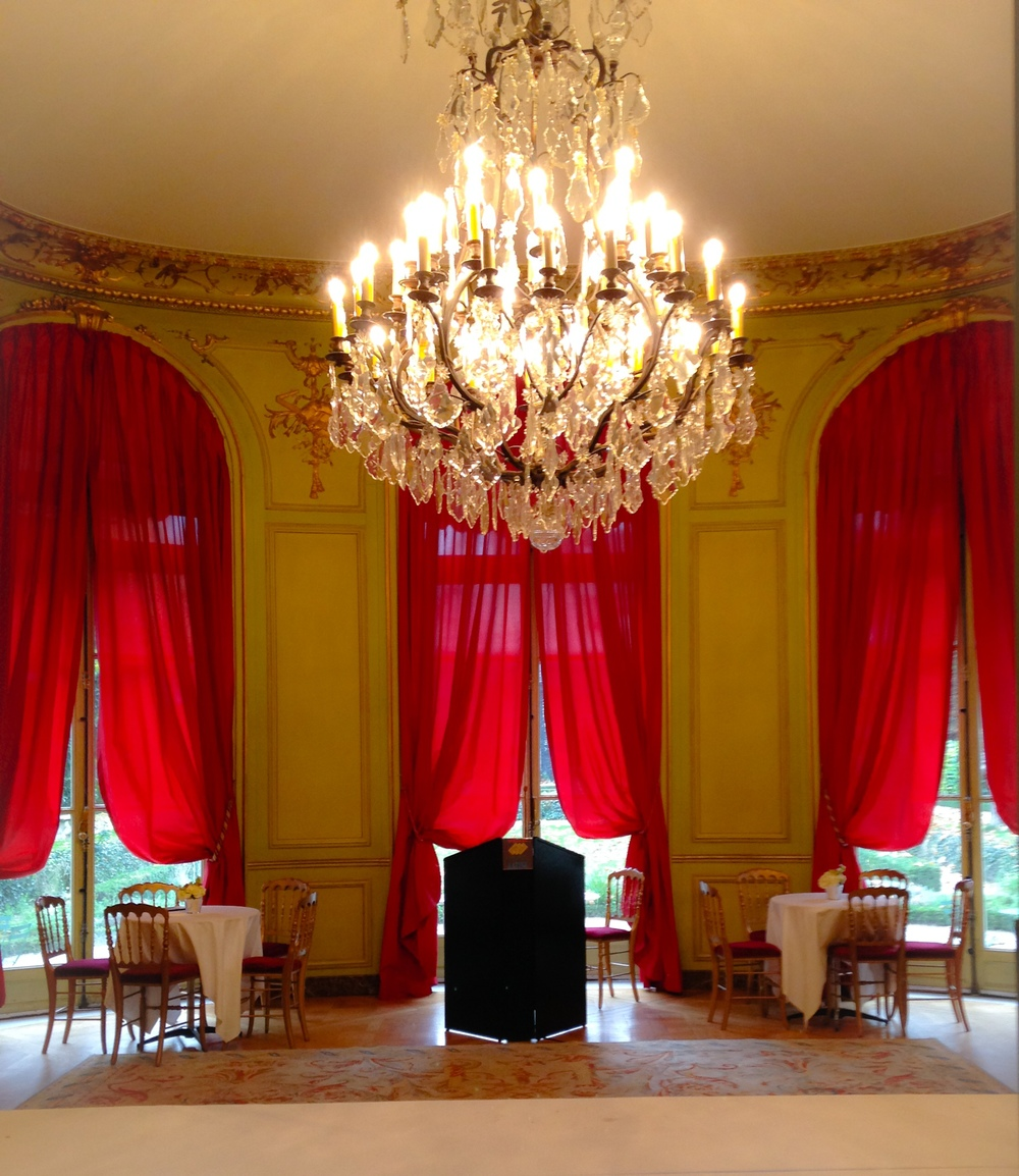 {View of one of the rooms used for a wedding reception. All of the rooms that are used for the reception have large chandeliers like this}