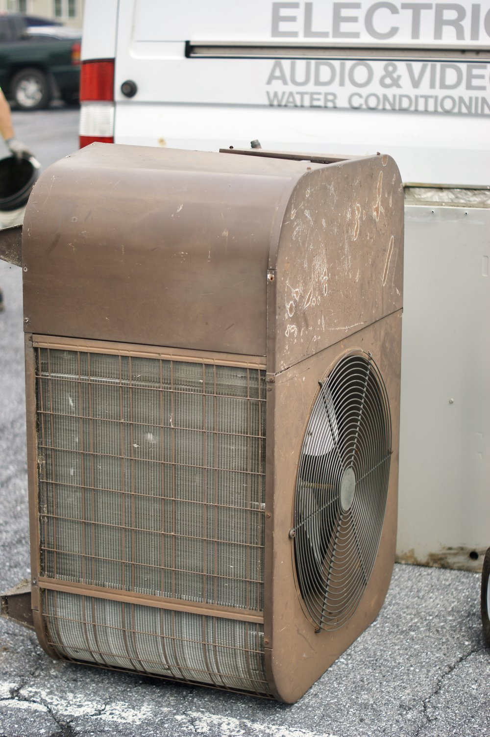 The old A/C unit awaits disposal.