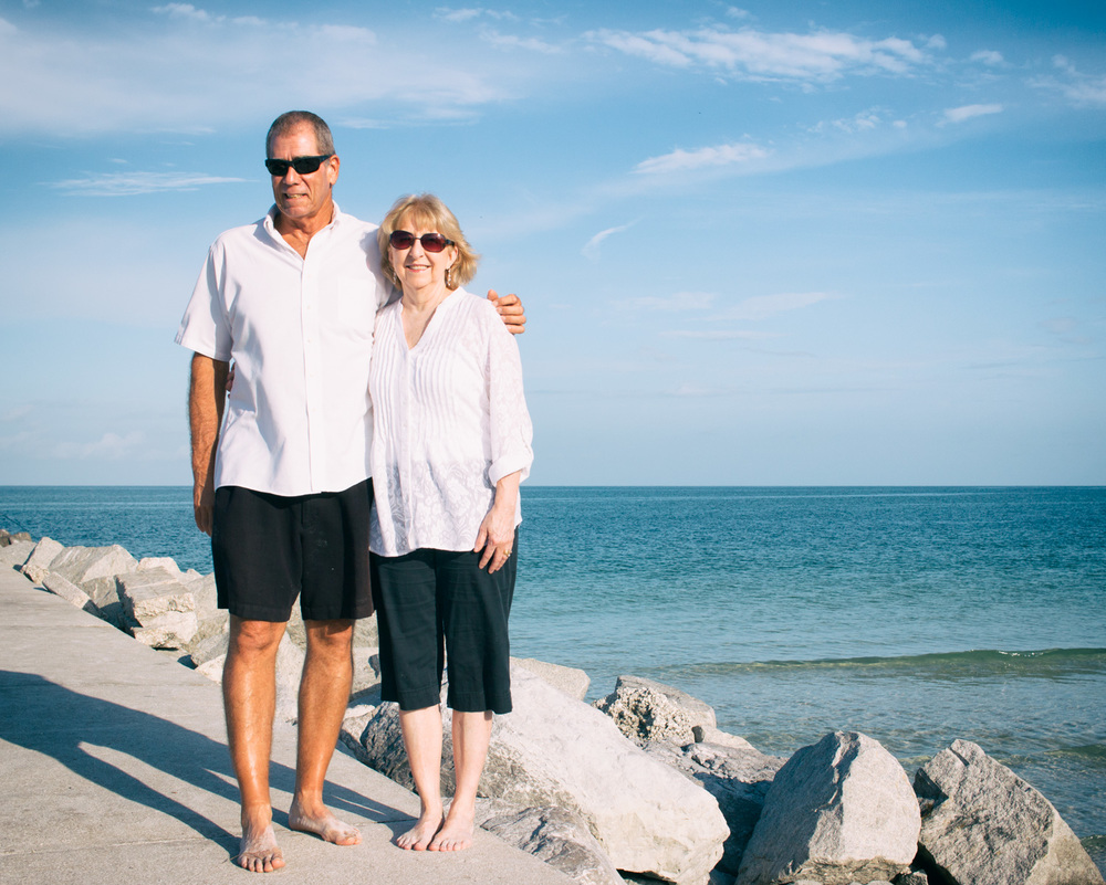 A cute couples photo along the raised walkway overlooking the water at Pass-a-Grille Beach.
