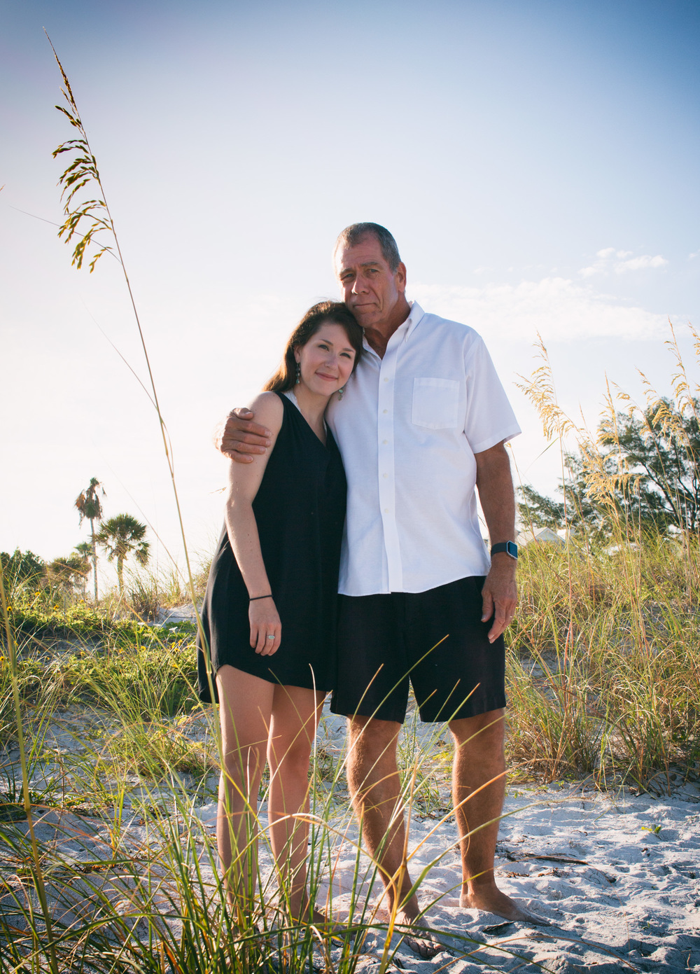A sweet father and daughter photo amongst the sand and long grass at Pass-a-Grille Beach.