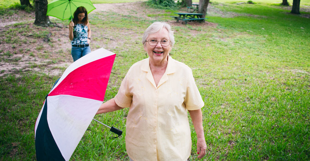 A bright, happy portrait of grandma at the park