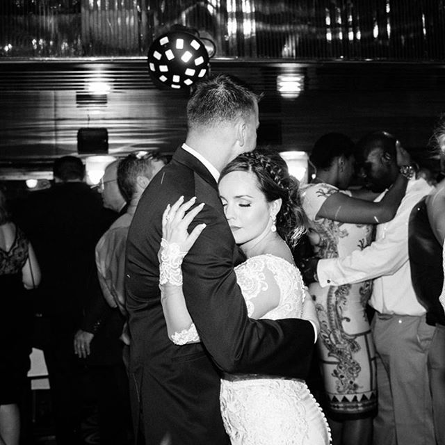 A sweet candid moment between the newlyweds as they slow dance.