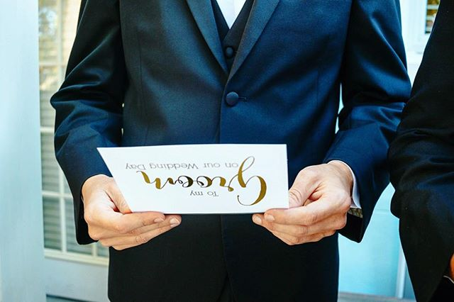 The details - the lucky groom reads a note from his bride with his groomsmen as they prepare.