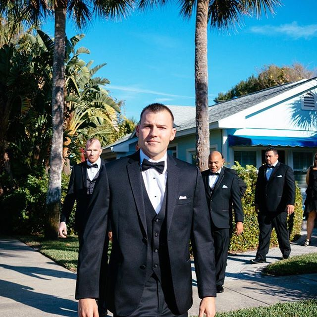 Best way to stop busy downtown Clearwater traffic: have the groom and his groomsmen stroll across the road to the beach in their tuxes. Also, I have mastered the little known art of walking backwards with a camera in my face. #suitedandbooted ⠀