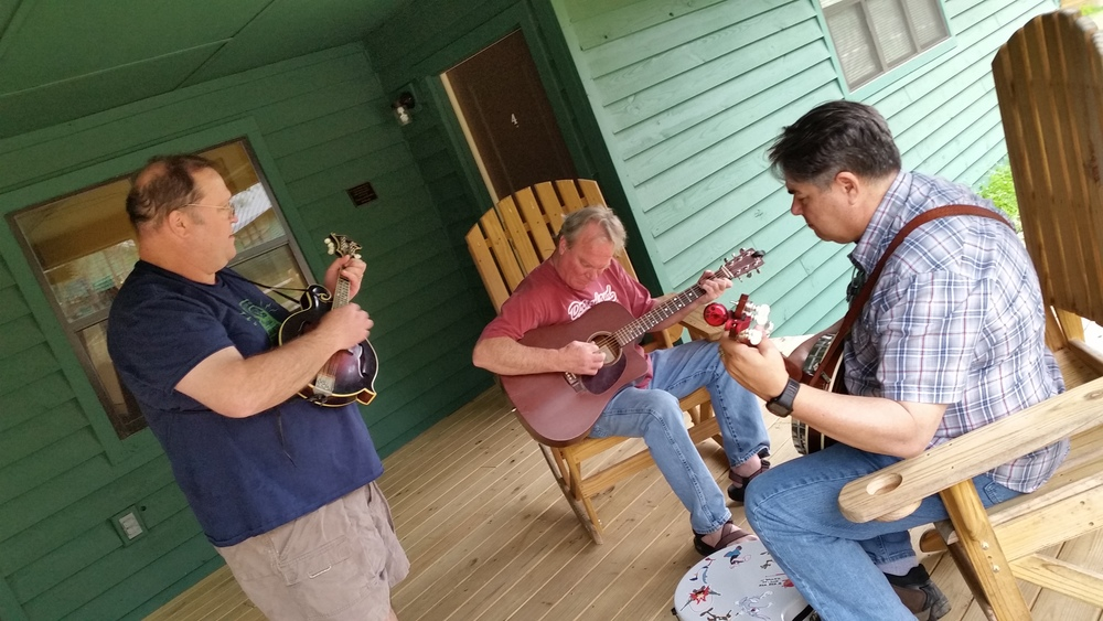 Students gather for an impromptu jam session on the porch during the Bluegrass & Gee's Bend workshop.