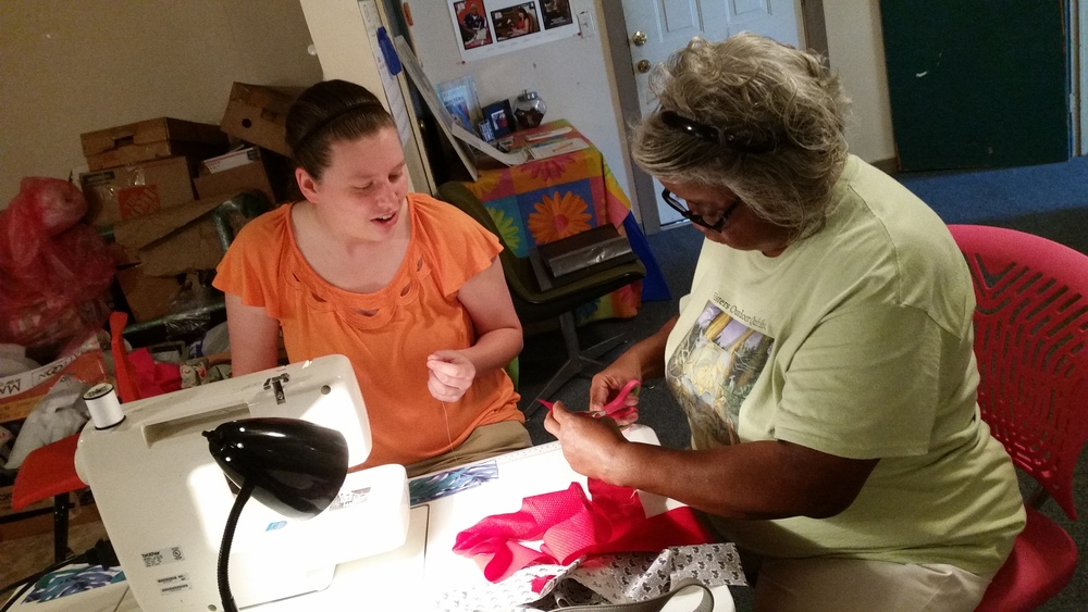 "Mary Ann Pettway teaches Whitley how to sew like, ""my momma taught me."""