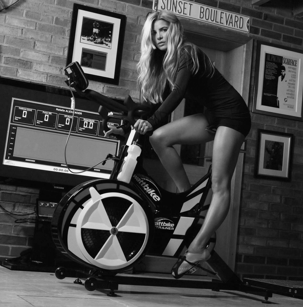 Natalie Alexander, my wife on the wattbike. She follows my unique protocol approach  on using this immense machine to gain considerable strength in  VO (2R) whilst losing and maintaining body fat loss