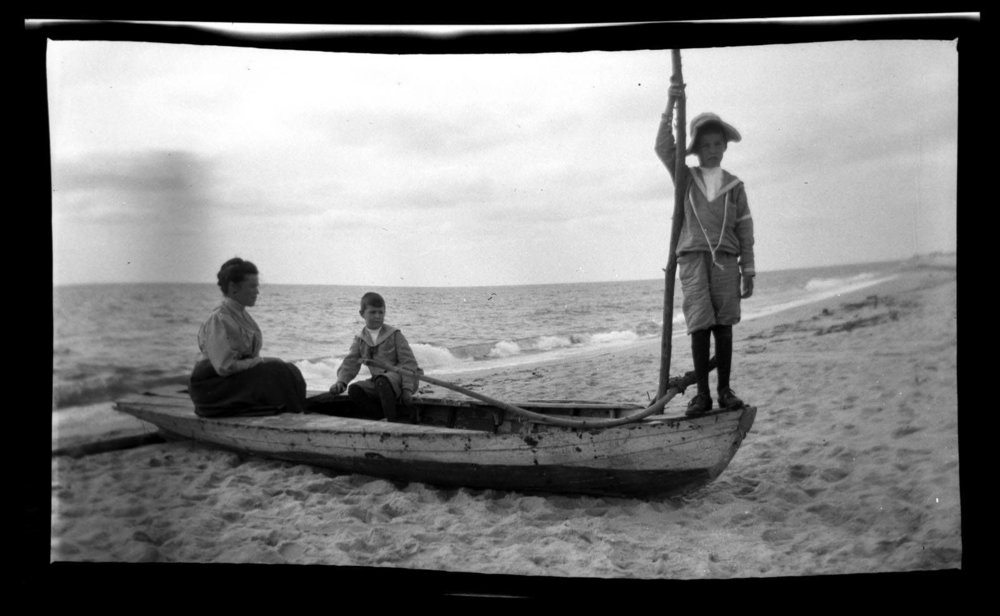 Two boys and woman in boat Sea Girt .jpg