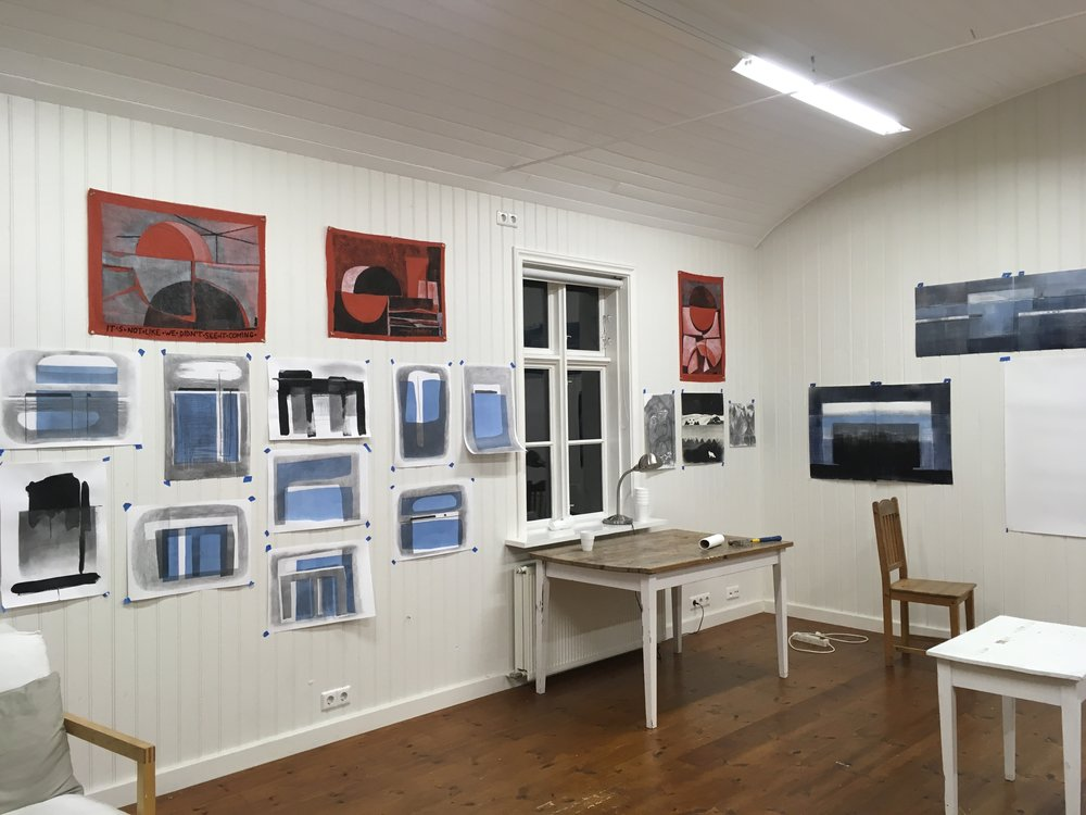 Northland images at Herhusid.  The three red, white, and black flags re-imagine the flag of Greenland.