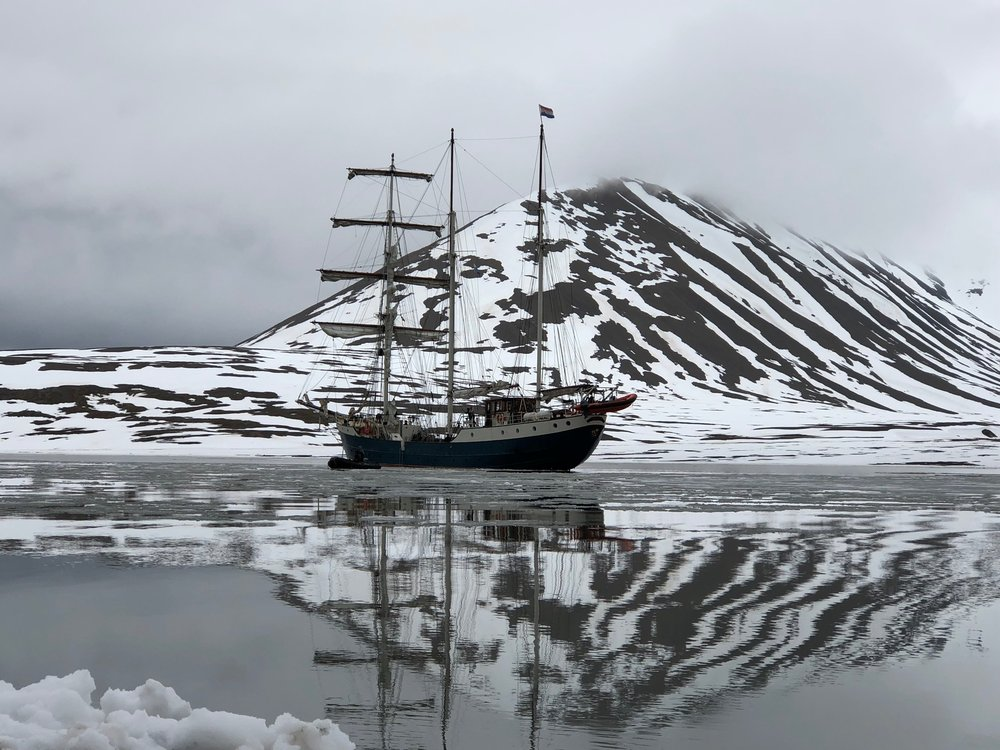 The Antigua anchored in Mushamna bay. Arctic Circle Residency, June, 2018.