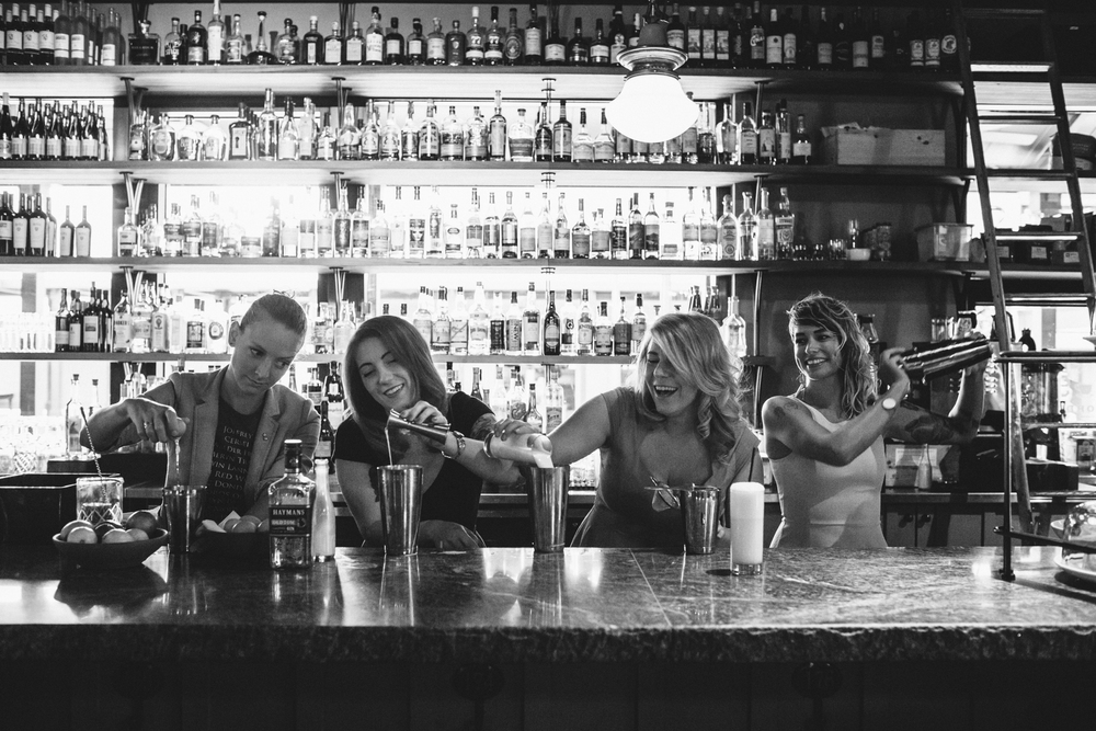 Madison Burch, Mercedes O'Brien, Kellie Thorn, and Shanna Mayo shake a Ramos gin fizz, infamous for being  the  most annoying drink in the world to make, at Empire State South in Midtown Atlanta.