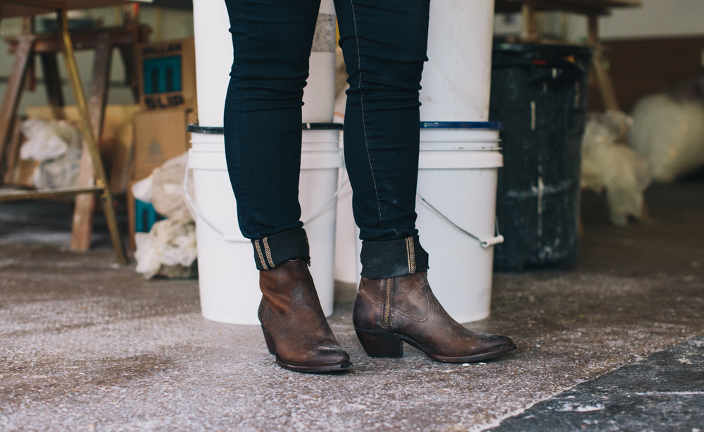 """My Frye boots are feminine with a tomboy edge"" Says Courtney. ""And comfortable. At nine months pregnant, I need comfortable!"" Boots: Sacha short in Dark Brown."
