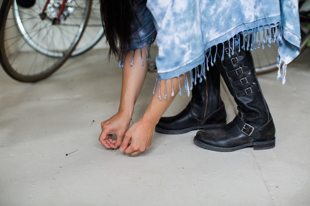 """I love ease and comfort. I'm wearing a flat boot from Frye. I love the worn-in look, I think flaws are beautiful, and I like the masculinity of the boots because I am a tomboy at heart."" Boot: Veronica Belted Tall."