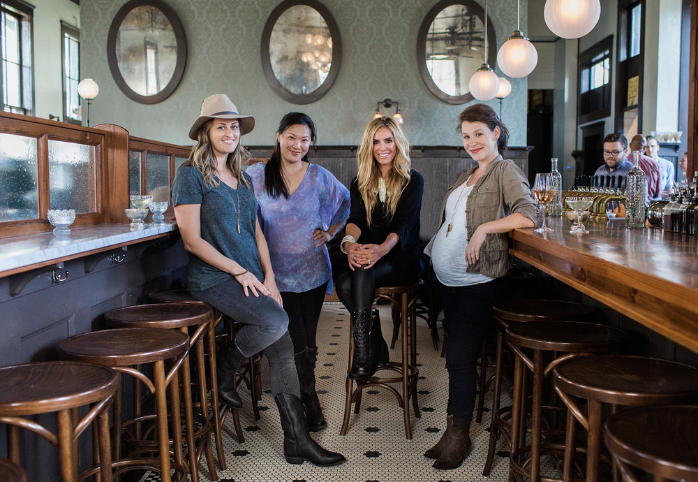 (L-R) heirloomed collection's Ashley Schoenith, Maridadi Trading's Vena Kim, S.Carter Designs' Sarah Hovis Olsen, and Honeycomb Studio's Courtney Hamill gather at Kimball House restaurant in Atlanta, Georgia.