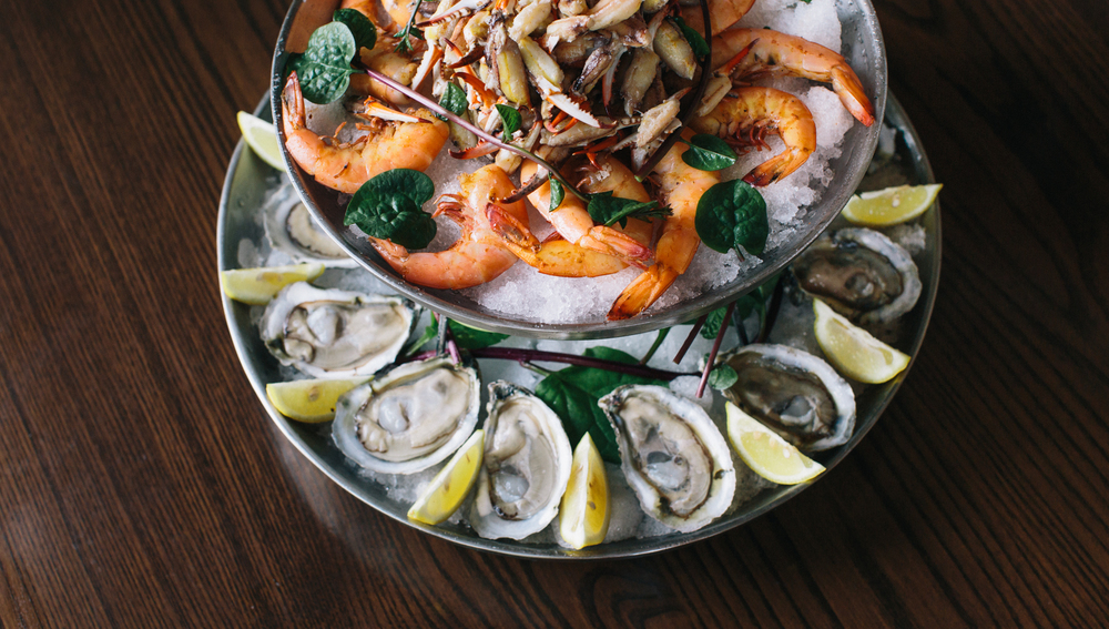 Alabama's own Mon Louis oysters outfit the ground tier of Acre's seafood platter. David had just returned from Auburn University Shellfish Lab at the Sea Lab on Alabama's Dauphin Island.