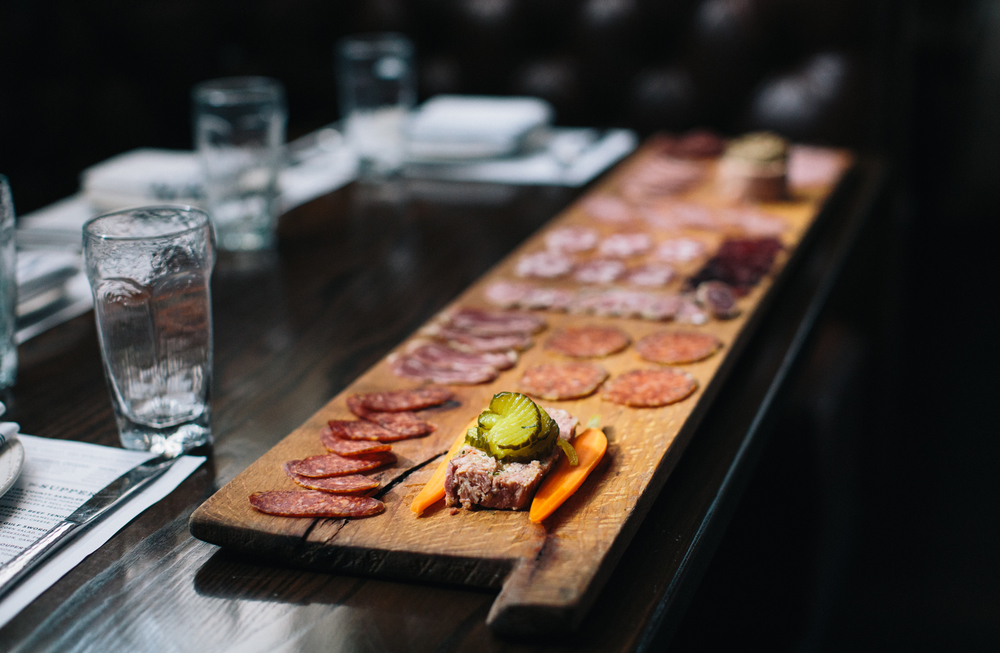 Eight feet of meat: all of Acre's charcuterie is house-cured from locally-raised animals, and served with a choice of Southern cheeses, peanut brittle, pecan mustard, house pickles and seasonal preserves.