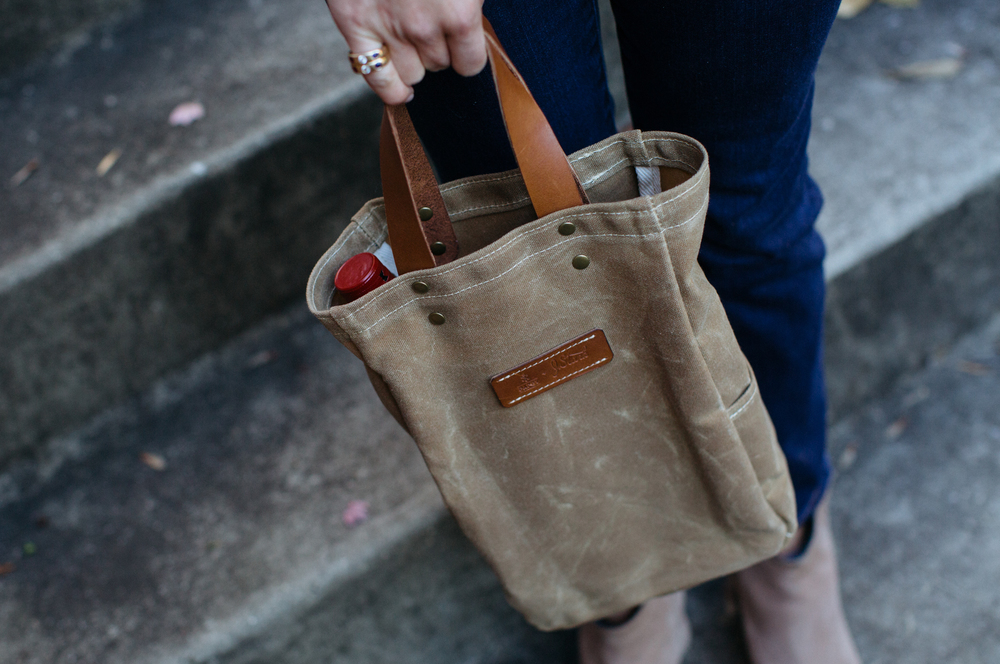 The collaborative Pappy & co.  waxed canvas whiskey tote .