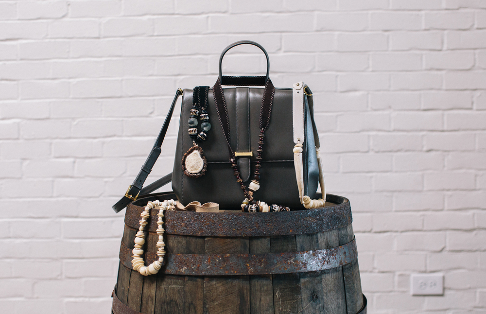 Twine & Twig necklaces draped over a Whitby handbag, from our 2015 Gift Guide for The Social Butterfly. Read our full story on Whitby's philanthropic heart here. Photo: Caroline Fontenot. Styling: Candice Beaty.