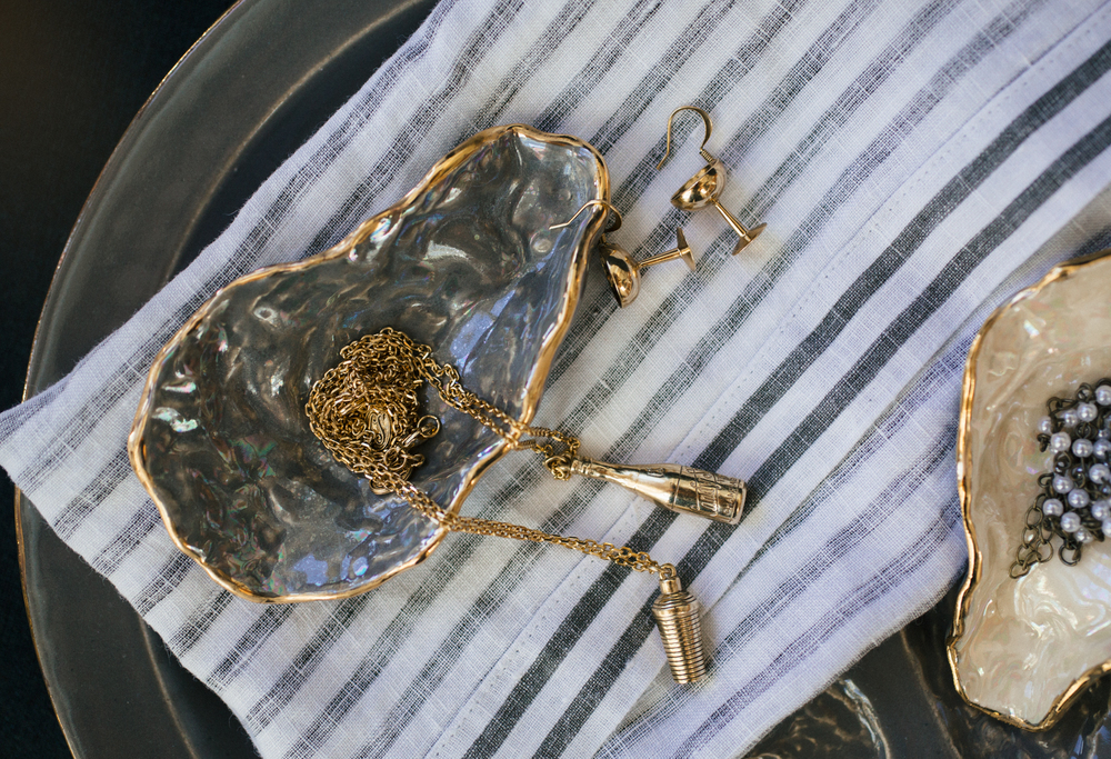 "Candy Shop Vintage jewelry in Heirloomed Collection oyster shell jewelry dishes from our 2015 ""Gift Guide for The Reveler"". Photo: Caroline Fontenot. Styling: Candice Beaty."