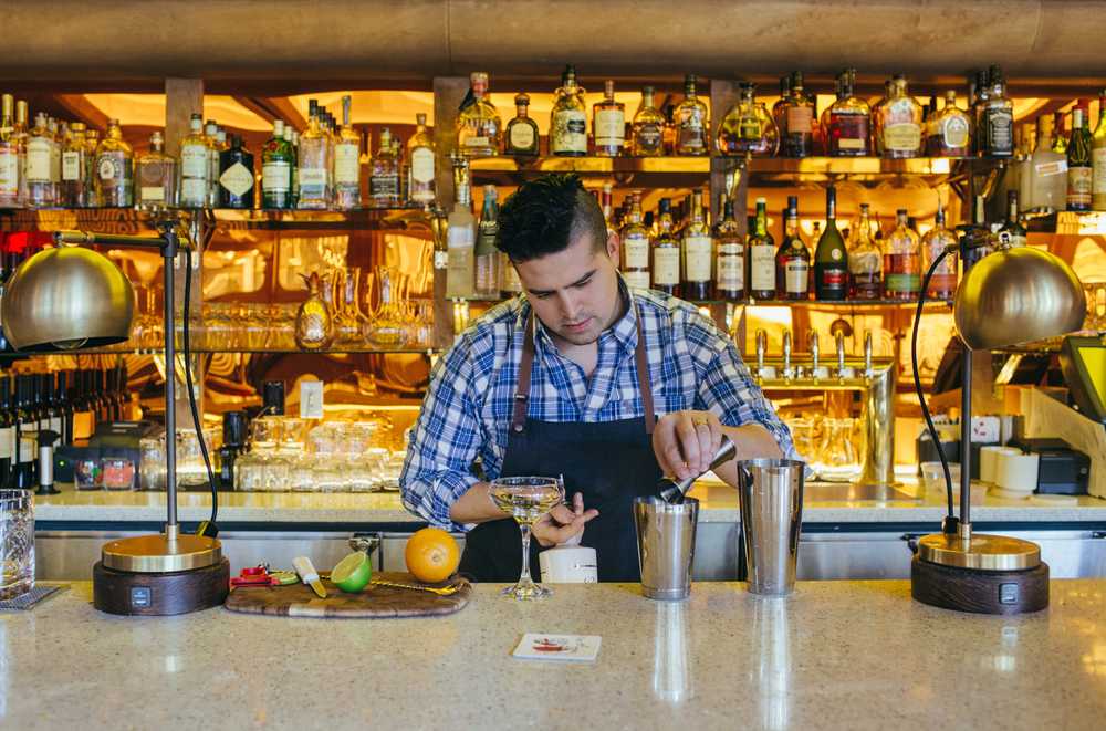 Beverage Manager Eduardo Guzman puts together unpretentious throwback cocktails in the downstairs lounge.