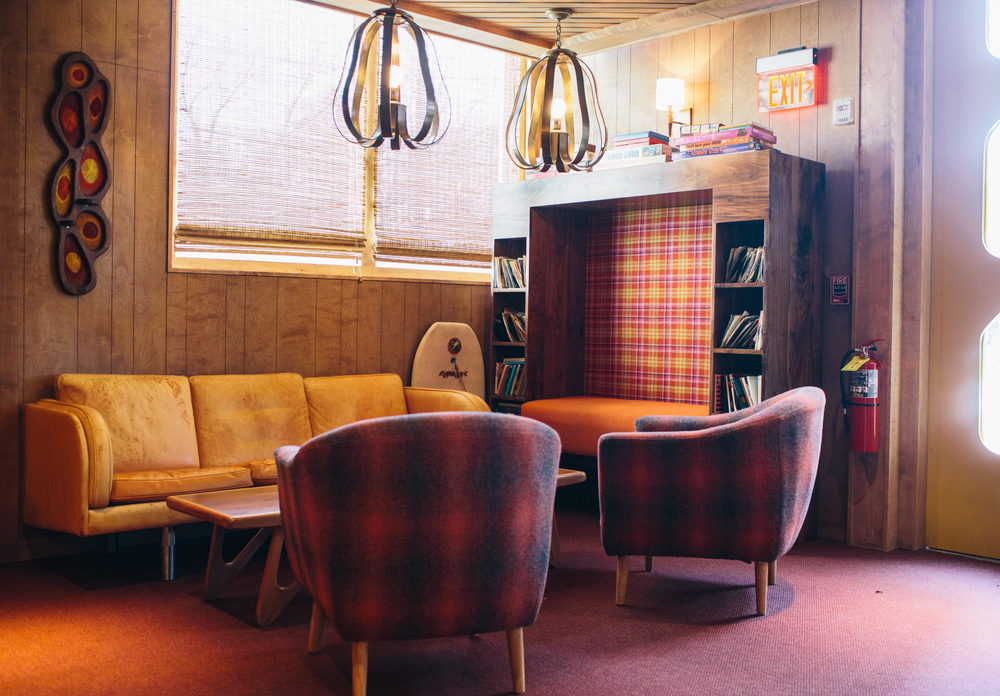 """Ingram and her team quickly built out the BeetleCat space, using materials like yacht flooring, paneled walls, and interesting tiles and woods. The two floors of the venue are distinct: there's the Montauk-inspired upstairs bar, while the downstairs is a nod to an early 1970s den – """"think where kids may have stirred up trouble when their parents were out of town,"""" Fry jokes."""